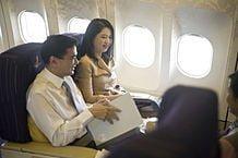 218px-Abhisit and Pimpen Vejjajiva on the flight to Singapore APEC CEO Summit 2009