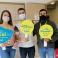 Colaboradores de Viva promoviendo la vacunación contra Covid-19.